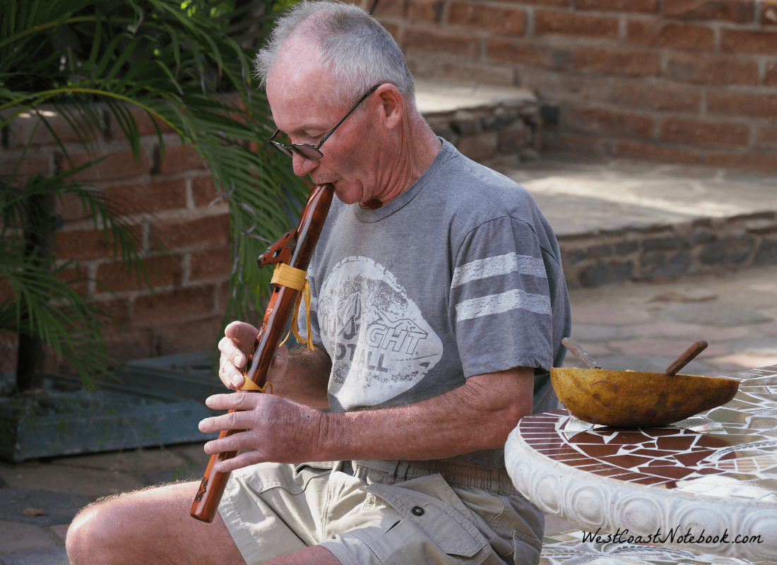 Rob playing the flute in the courtyard